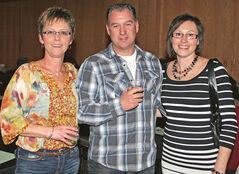 Classified dep't supervisor Debbie Bessette, sales representative Rob McEwen and Carolyn McEwen.