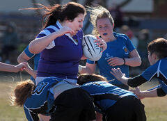 Vincent Massey's Brittany Boschman is swarmed by Souris defenders in high school rugby action on Tuesday.