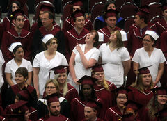 ACC graduates enjoy a light moment during Thursday's ceremony.