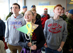 Sarah Olive anxiously looks for her father, Capt. Kevin Olive, to come through the arrivals gate at the Brandon Municipal Airport on Tuesday while waiting with her brothers, Michael and Matthew, and mother Lisa. Olive was the task force chaplain for the final Canadian mission in Afghanistan.