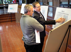 Graeme Loeppky of Dillon Consulting explains the options for the Eighth Street bridge to Myles Harper during a public consultation on last year at city hall.