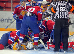 A scuffle between the Brandon Wheat Kings and Edmonton Oil Kings breaks out in front of the Edmonton net during Tuesday night's game.