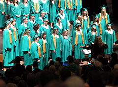 Students sing the national anthem during the École secondaire Neelin High School graduation ceremony at the Western Manitoba Centennial Auditorium on Tuesday afternoon.