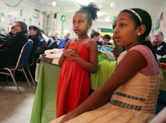 Selam Beyene (left) and Samriy Yigzaw watch the show at the Ethiopian pavilion on Friday evening.