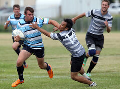Clément LePage of the Brandon Barbarians (left) fends off an opposing player during Sunday's match at John Reilly Field.