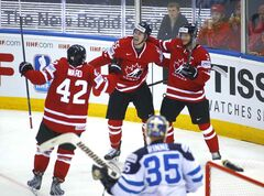 Canada's players celebrate after Mark Scheifele scored against Finland during the Group A Quarterfinal match at the Ice Hockey World Championship in Minsk, Belarus, Thursday, May 22, 2014. (