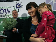 Adrienne Percy (centre), of the Nourished Roots farm, along with her daughter Hannah, 6, present Conservation and Water Stewardship Minister Gord Mackintosh with a pesticide-free lavender plant at Tuesday's announcement.