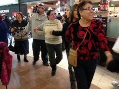 Men, women and children form a circle around the food court at Shoppers Mall on Friday evening in support of the national Idle No More protest.