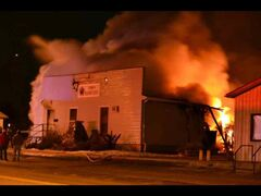 The Rapid City town office and fire hall are engulfed in flames late Sunday night.