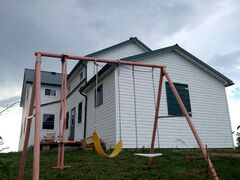 A swing set stands empty outside a home at a Manitoba Old Order Mennonite community. All the community's children, about 40, were removed by CFS in January and June due to allegations of physical abuse related to discipline and placed in foster homes across southern Manitoba with Mennonite caregivers.