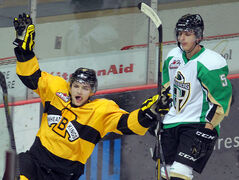 Brandon Wheat Kings' John Quenneville celebrates his goal as Raider Tomas Andrlik skates past during hockey action on Saturday evening.