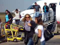 Passengers disembark from WestJet's inaugural Calgary-to-Brandon  flight in September.