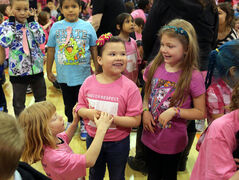 Kruz Wilson, left, Sidney Curtis, centre, and Emma Osborne play during events for the third annual Red Cross Day of Pink at New Era School on Wednesday. The campaign encourages students and school staff to wear pink as a visible statement against bullying.