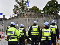 A NATO flag and flags of many nations fly from the ramparts of Cardiff Castle as a heavy police presence secures the area outside security fencing surrounding the castle ahead of the upcoming NATO summit in Newport, Wales, Monday Sept. 1, 2014. Wales will host a NOTO summit at Celtic Manor Resort in Newport, Mon Sept. 4 to 5, and with other events in Cardiff, which is expected to include US President Obama, German Chancellor Merkel, and President Hollande of France, along with leaders and senior ministers from around 60 other countries. (AP Photo / Ben Birchall, PA) UNITED KINGDOM OUT - NO SALES - NO ARCHIVES