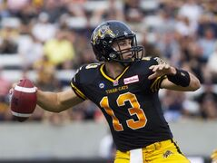 Hamilton Tiger-Cats quarterback Dan LeFevour looks to pass during their home opener against the Ottawa Redblacks in CFL action in Hamilton, Ont., Saturday, July 26, 2014. LeFevour was named CFL offensive player of the week Monday after leading the Tiger-Cats to a 33-23 win over Ottawa in his first career CFL start. THE CANADIAN PRESS/Aaron Lynett