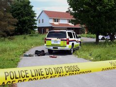 Police tape blocks the scene where two Ottawa police officers and three paramedics were injured during a training exercise in the Kanata, Ont. in the west end of Ottawa, Wednesday June 18, 2014. THE CANADIAN PRESS/Fred Chartrand