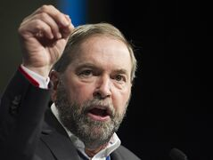 NDP Leader Thomas Mulcair gestures during a speech to delegates at the Canadian Labour Congress in Montreal, Thursday, May 7, 2014. THE CANADIAN PRESS/Graham Hughes