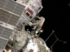 Russian space station crew member Oleg Artemiev floats outside the International Space Station during a space walk by two Russians, Thursday, June 16, 2014, to install a new antenna and move a cargo boom. Alexander Skvortsov and Artemiev will also switch out some science experiments. (AP Photo/NASA-TV)