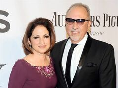 FILE - In this June 8, 2014, file photo, Gloria Estefan, left, and Emilio Estefan pose for photos at the 68th annual Tony Awards at Radio City Music Hall in New York. Producers of