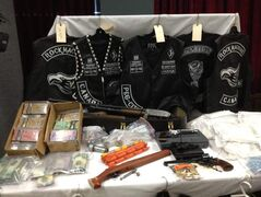 The RCMP seized pipe bombs, other explosives, weapons, several pounds of cocaine and marijuana, 1,800 pills of BZP, a synthetic ecstasy, boxes of cash, and Rock Machine hoodies, patches and other gang clothing.
