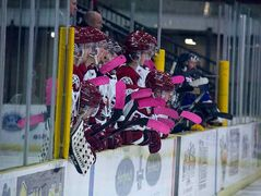 "Pink is predominate on the Virden Oil Caps bench during the team's Oct. 20 ""Pink Night""."