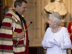 Britain's Queen Elizabeth II, right, smiles at Earl Marshall as she leaves the Palace of Westminster, after delivering the Queen's Speech in the House of Lords at the State Opening of Parliament, in London, Wednesday, June, 4, 2014. The State Opening of Parliament is an annual pageant of pomp and politics centred on the Queen's Speech, a legislative program written by the government but read out by the monarch before a crowd of lawmakers, ermine-robed peers and ceremonial officials in bright garb evoking centuries past. (AP Photo/Alastair Grant, Pool)