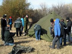 Sgt. Cory Rein from 1 RCHA CFB Shilo instructs cadets on setting up 10-man bell tent.