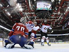 Team Canada's Joel Ward, right, celebrates the goal scored by teammate Mark Scheifele (55) against Norway's Steffen Soberg during second period action Tuesday, May 20, 2014 at the IIHF World Hockey Championship in Minsk Belarus. THE CANADIAN PRESS/Jacques Boissinot