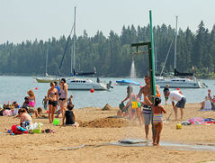 In this July photo, visitors to the Clear Lake beach in Wasagaming take advantage of the warm temperatures. A Riding Mountain National Park official says the number of visitors is up significantly this summer. The campground recorded a 10 per cent jump in campers compared to the same time in 2011.
