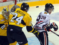 Brandon Wheat Kings forward Jens Meilleur and goaltender Corbin Boes watch the puck fly past the head of Portland Winterhawks forward Brendan Leipsic in Western Hockey League action on Friday night at Westman Place.