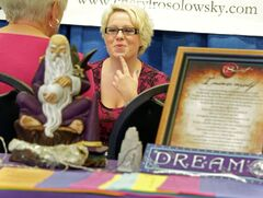 Cheryl Rosolowsky reads tarot cards at the ESP Psychic Fair, Wednesday afternoon. The array of readers will be open to the public until 7pm tonight at the Trails West hotel.