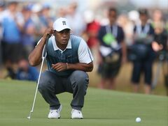 Tiger Woods of the US looks at his putt on the 2nd green during the first day of the British Open Golf championship at the Royal Liverpool golf club, Hoylake, England, Thursday July 17, 2014. (AP Photo/Peter Morrison)