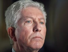 Former Bloc Quebecois leader Gilles Duceppe is shown talking to media after appearing before the Commons Board of Internal Economy on Parliament Hill in Ottawa, Monday February 13, 2012. THE CANADIAN PRESS/Fred Chartrand