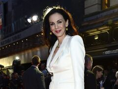 FILE - This Oct. 18, 2012 file photo shows fashion designer L'Wren Scott at the London Film Festival American Express Gala for