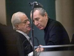 Vito Rizzuto (right) speaks with his attorney Jean Salois in Montreal on Feb. 6, 2004. Radio-Canada is reporting that Vito Rizzuto, the reputed head of the Montreal Mafia, has died. THE CANADIAN PRESS/Ryan Remiorz