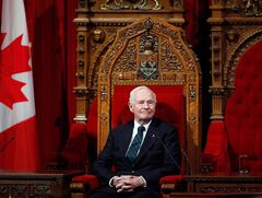 Governor General David Johnston oversees a ceremony giving royal assent to government legislation in the Senate on Parliament Hill in Ottawa on Thursday, December 12, 2013. Johnston is sending a special holiday message to the families of military personnel coping with a recent series of suicides.THE CANADIAN PRESS/ Patrick Doyle