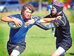 Brandon Barbarians' Brad Lewis fends off Winnipeg Wasps' Luke McKim during rugby action Saturday afternoon at John Reilly Field.