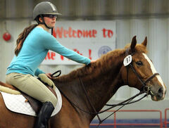 Haley Stewart pats her horse Torchsong while warming up at the Keystone Centre on Saturday during preparations for the annual Royal Manitoba Winter Fair. The Winter Fair kicks off today, with the opening ceremony set for 6:30 p.m. at Westman Place.