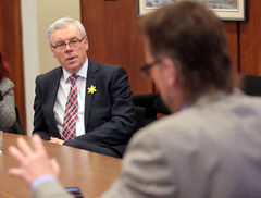 Premier Greg Selinger faces Brandon Sun managing editor James O'Connor as the premier attends a Sun editorial board meeting after delivering his State of the Province address on Thursday.