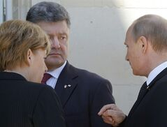 German Chancellor Angela Merkel, left, Russian President Vladimir Putin, right, and Ukrainian president-elect Petro Poroshenko, center, talk after a group photo before a luncheon as they take part in the 70th anniversary of D-Day in Benouville in Normandy, France, Friday, June 6, 2014. (AP Photo/Charles Dharapak)