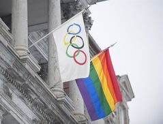 The rainbow flag flies over city hall alongside the Olympic flag in Montreal, Friday, February 7, 2014, for the duration of the Winter Olympic games in Sochi. THE CANADIAN PRESS/Graham Hughes
