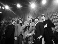 FILE - In this Feb. 8, 1964 file photo, Ed Sullivan, center, stands with The Beatles, from left, Ringo Starr, George Harrison, John Lennon, and Paul McCartney, during a rehearsal for the British group's first American appearance, on the