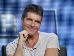 FILE - This Aug. 1, 2013 file photo shows Simon Cowell, a judge on the