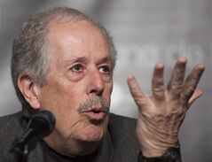 Filmmaker Denys Arcand speaks during a news conference in Montreal, Tuesday, May 6, 2014. A revered movie master and a much-feted up-and-comer - both from Quebec - are set to make a splash at the upcoming Toronto International Film Festival. THE CANADIAN PRESS/Graham Hughes