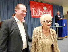 Rolf Dinsdale leaves the podium with his mother Lenore after winning the Liberal nomination for Brandon-Souris on Wednesday evening.
