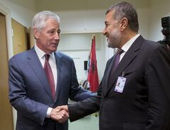 U.S. Defense Secretary Chuck Hagel, left, shakes hands with Afghanistan's Defense Minister Bismillah Khan Mohammadi, right, ahead of their North Atlantic Council (NAT) meeting, in Brussels, Wednesday, June 4, 2014. (AP Photo/Pablo Martinez Monsivais, Pool)