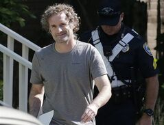 Peter Theo Curtis smiles as he walks towards reporters to read a statement outside his mother's home in Cambridge, Mass., Wednesday, Aug. 27, 2014. The release of the U.S. journalist Curtis by Syrian captors has prompted