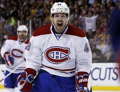 Montreal Canadiens center Daniel Briere (48) celebrates Dale Weise's goal against the Boston Bruins during the first period in Game 7 of an NHL hockey second-round playoff series in Boston, Wednesday, May 14, 2014.The Canadiens have traded veteran forward Briere to the Colorado Avalanche in exchange for forward Pierre-Alexandre Parenteau and a fifth-round pick in 2015 draft.THE CANADIAN PRESS/AP/Elise Amendola