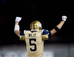 Winnipeg Blue Bombers quarterback Drew Willy celebrates after throwing the game tying touch down with second left against the Hamilton Tiger-Cats during second half CFL football action in Hamilton, Ont., on July 31, 2014. Drew Willy and the surprising Winnipeg Blue Bombers can take a big step towards proving they're for real Thursday night. Winnipeg hosts the Saskatchewan Roughriders at Investors Group Field. The Bombers (5-1) have been the CFL's biggest surprise this year, sitting atop the West Division standings after winning just three games all of last season. THE CANADIAN PRESS/Nathan Denette