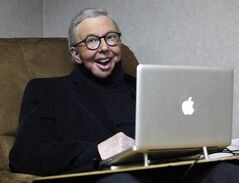 FILE - In this Jan. 12, 2011 file photo, film critic Roger Ebert works in his office at the WTTW-TV studios in Chicago. When